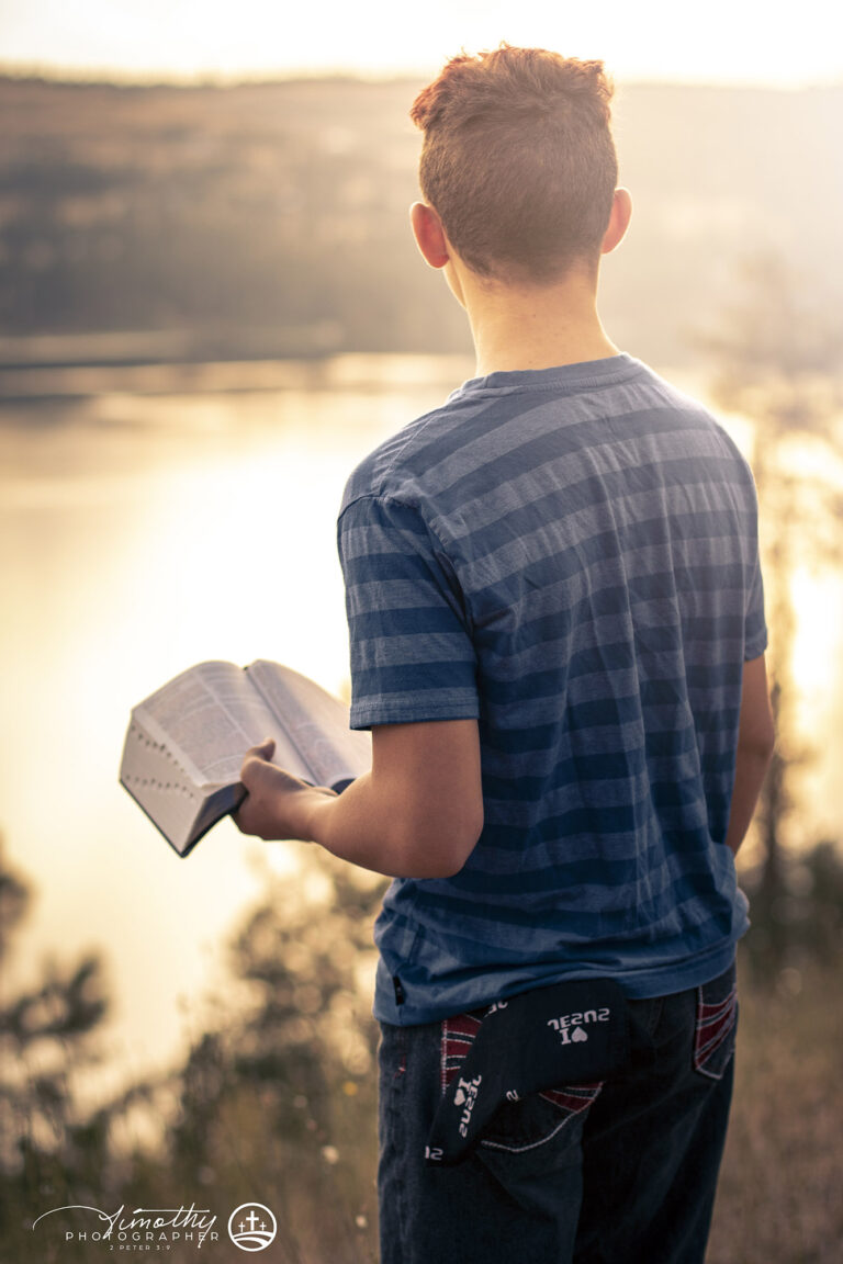 youth holding bible