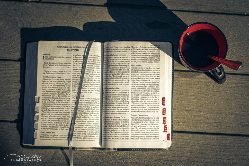 open bible on table outside