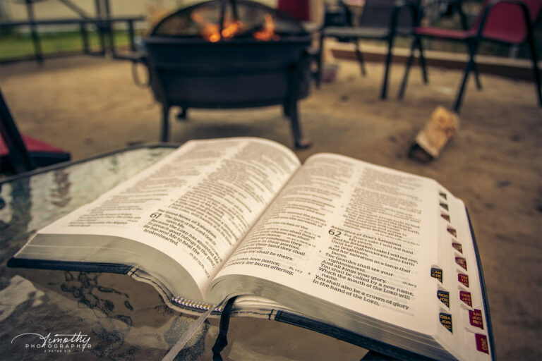 bible outside by the morning fire