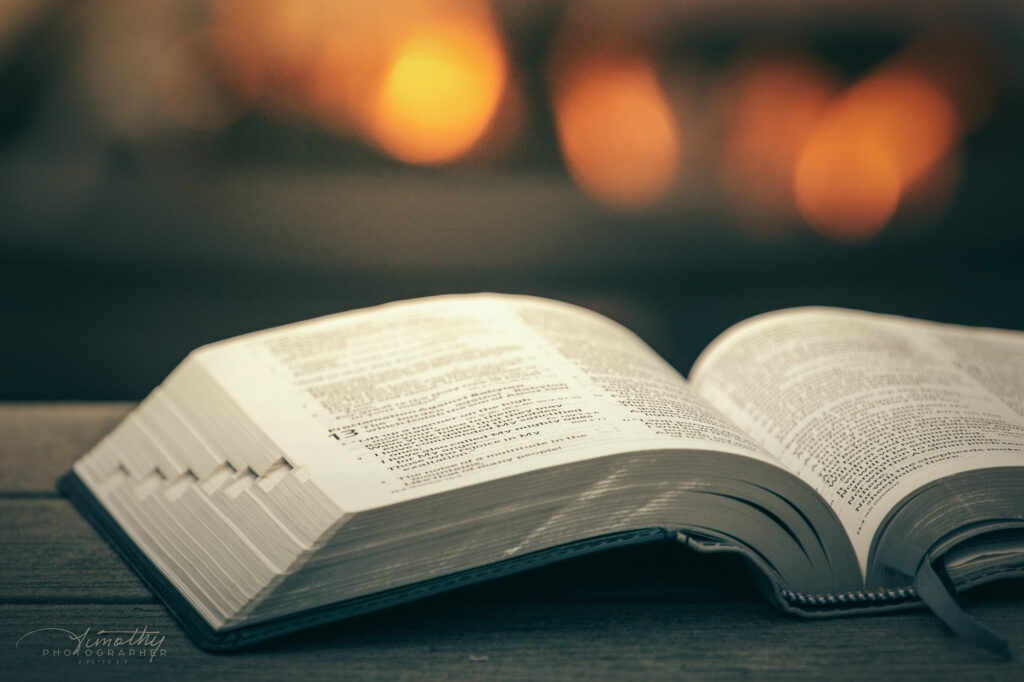 bible image of bible outside by the fire