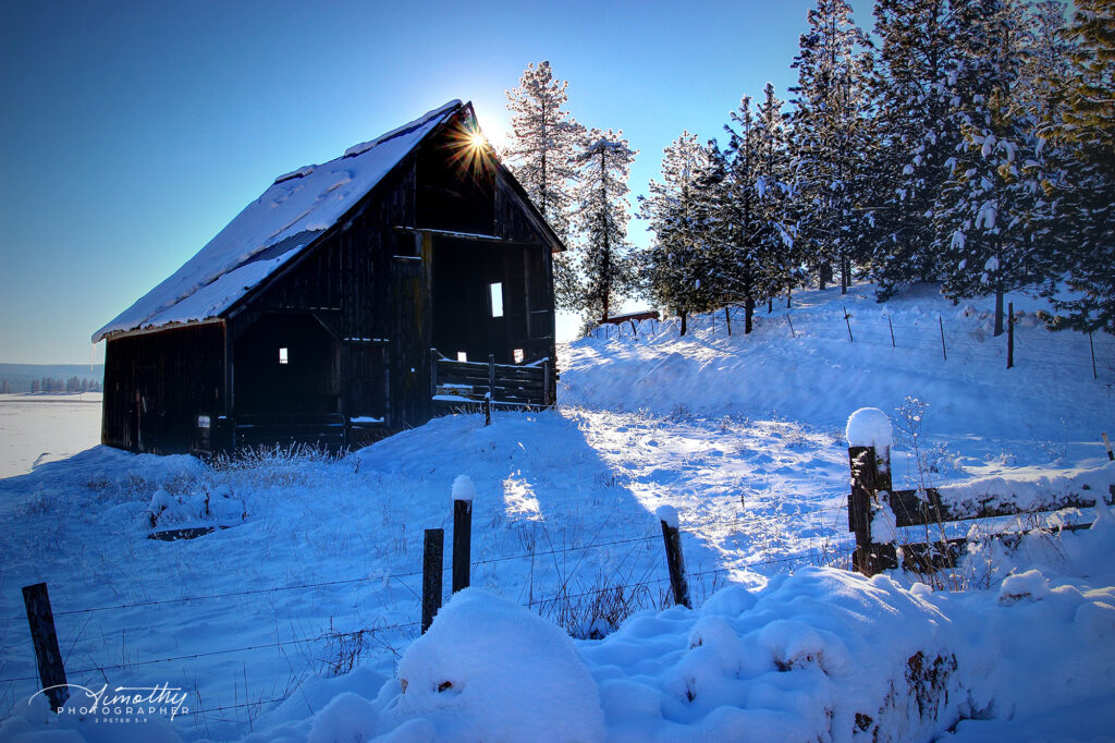 Barn in the snow with blue sky