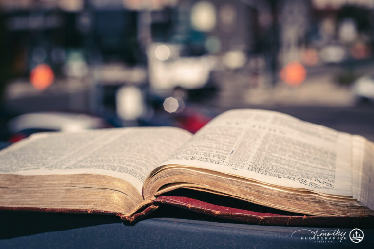 Bible with the city in the background