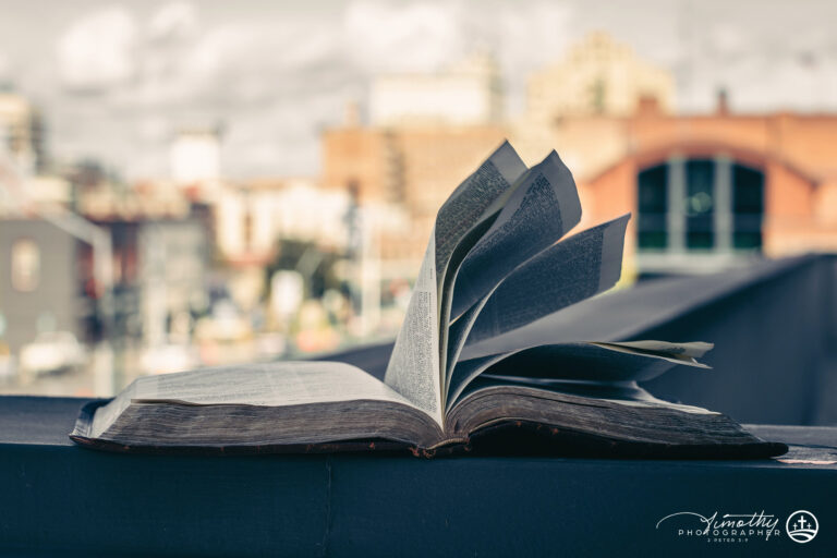 Bible with city in the background