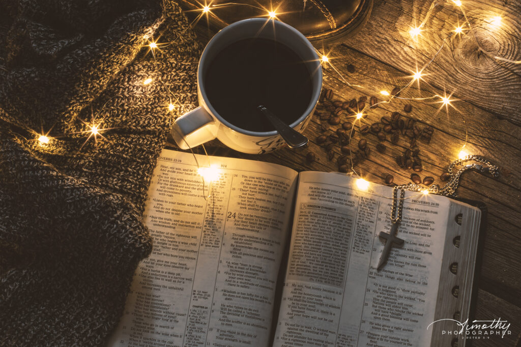 free image of bible with Christmas lights and coffee