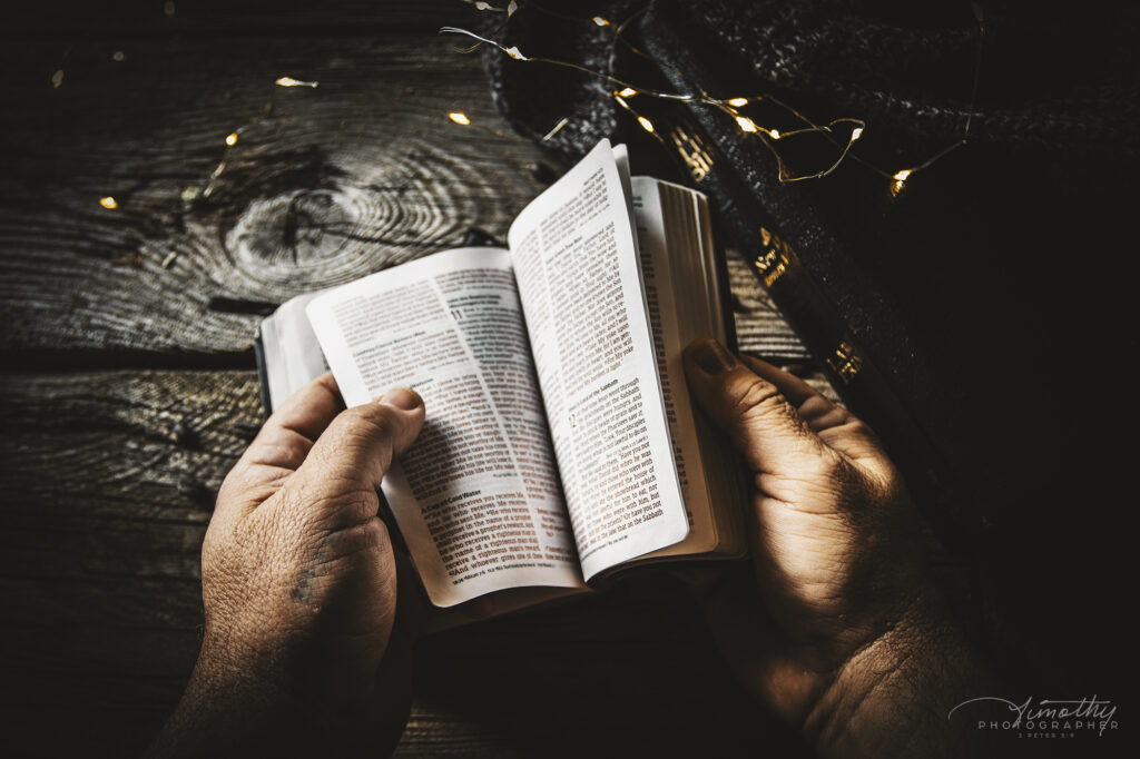 Hands flipping through the bible