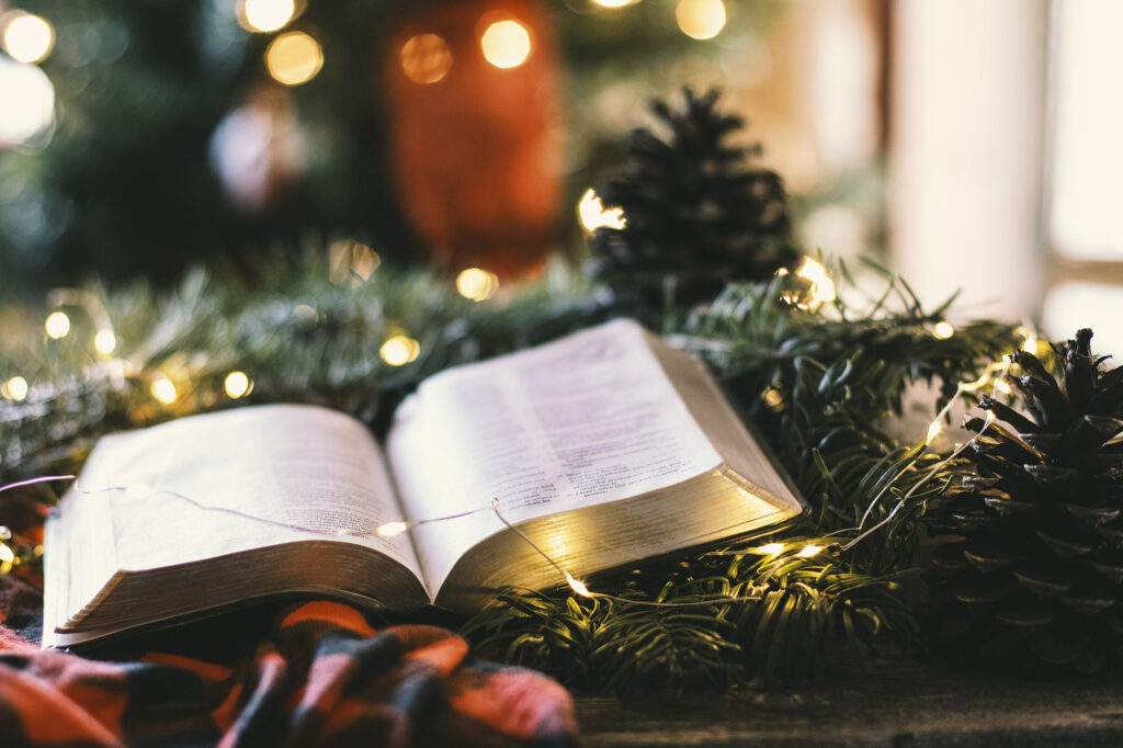 Bible in front of Christmas tree